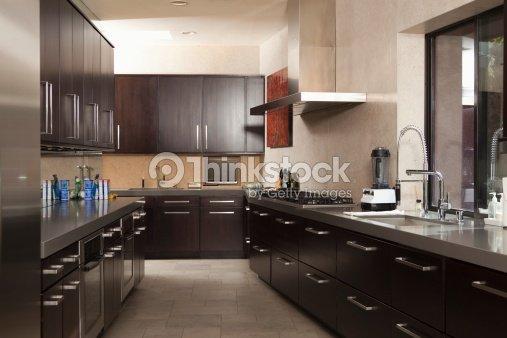 Dark Wood Galley Kitchen Stock Photo Thinkstock
