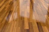 Close-up view of dark wood parquet floor, background