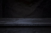 Dark wooden board table for product display montage, black wooden perspective interior