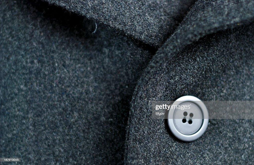 Dark wool coat with one black button