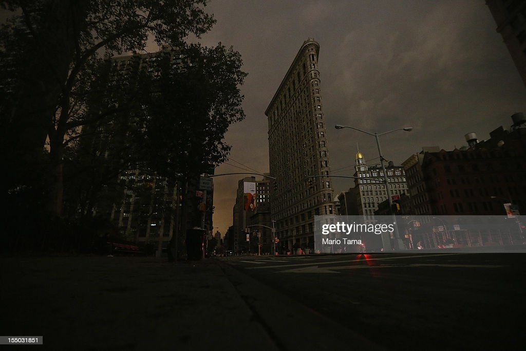 A darkened Flatiron Building rises over an empty street in a section of Manhattan still in a blackout following Hurricane Sandy on October 30, 2012 in New York City. The storm has claimed at least 40 lives in the United States, and has caused massive flooding across much of the Atlantic seaboard. US President Barack Obama has declared the situation a 'major disaster' for large areas of the US East Coast including New York City.