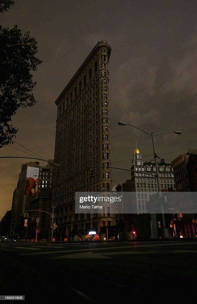 A darkened Flatiron Building stands in a section of Manhattan still in a blackout following Hurricane Sandy on October 30, 2012 in New York City. The storm has claimed at least 40 lives in the United States, and has caused massive flooding across much of the Atlantic seaboard. US President Barack Obama has declared the situation a 'major disaster' for large areas of the US East Coast including New York City.