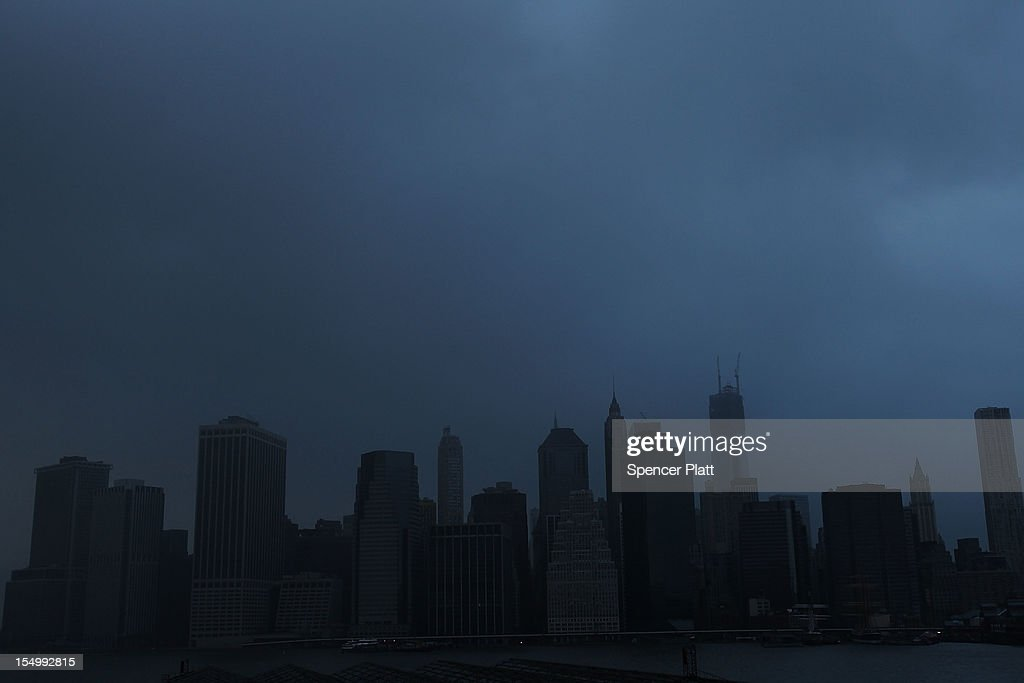 A darkened Manhattan is viewed after much of the city lost electricity due to the affects of Hurricane Sandy on October 30, 2012 in New York, United States. At least 33 people were reported killed in the United States by Sandy as millions of people in the eastern United States have awoken to widespread power outages, flooded homes and downed trees. New York City was his especially hard with wide spread power outages and significant flooding in parts of the city.