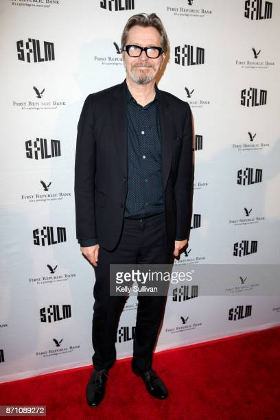 'Darkest Hour' actor Gary Oldman poses for photos on the red carpet at the Castro Theatre on November 6 2017 in San Francisco California