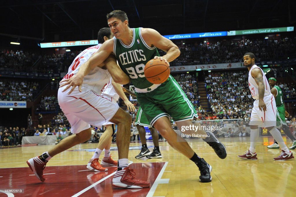 Darko Milicic #99 of the Boston Celtics drives the ball against defense during the game between the Boston Celtics and the EA7 Emporio Armani Milano on October 7, 2012 at Mediolanum Forum in Milan, Italy.