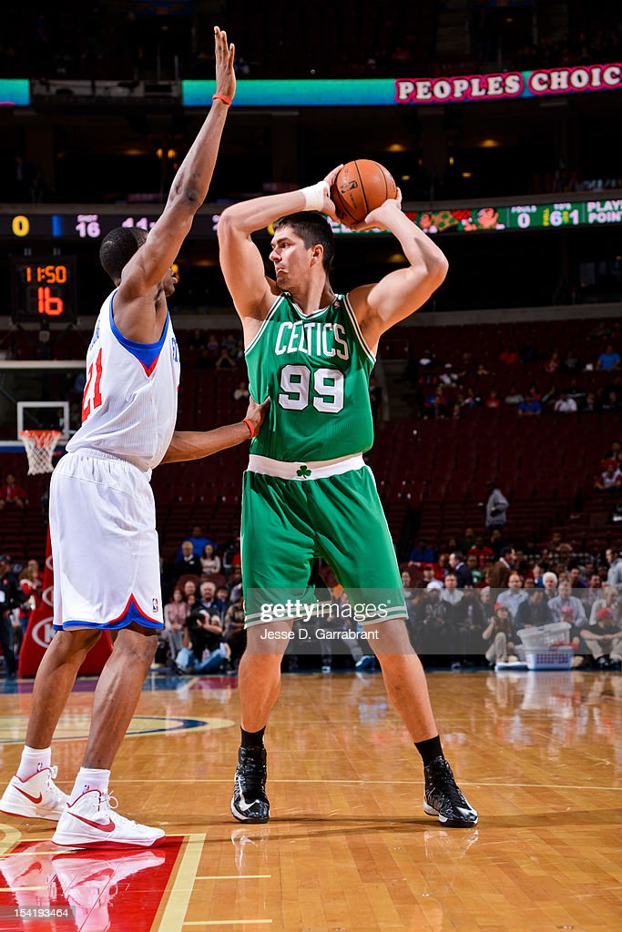 Darko Milicic #99 of the Boston Celtics looks to pass the ball against Thaddeus Young #21 of the Philadelphia 76ers during a pre-season game at the Wells Fargo Center on October 15, 2012 in Philadelphia, Pennsylvania.