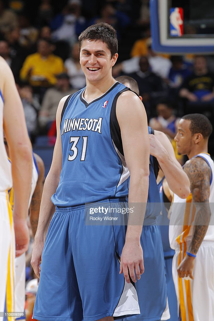 Darko Milicic #31 of the Minnesota Timberwolves shoots a smile over to the Golden State Warrior bench on March 13, 2011 at Oracle Arena in Oakland, California.