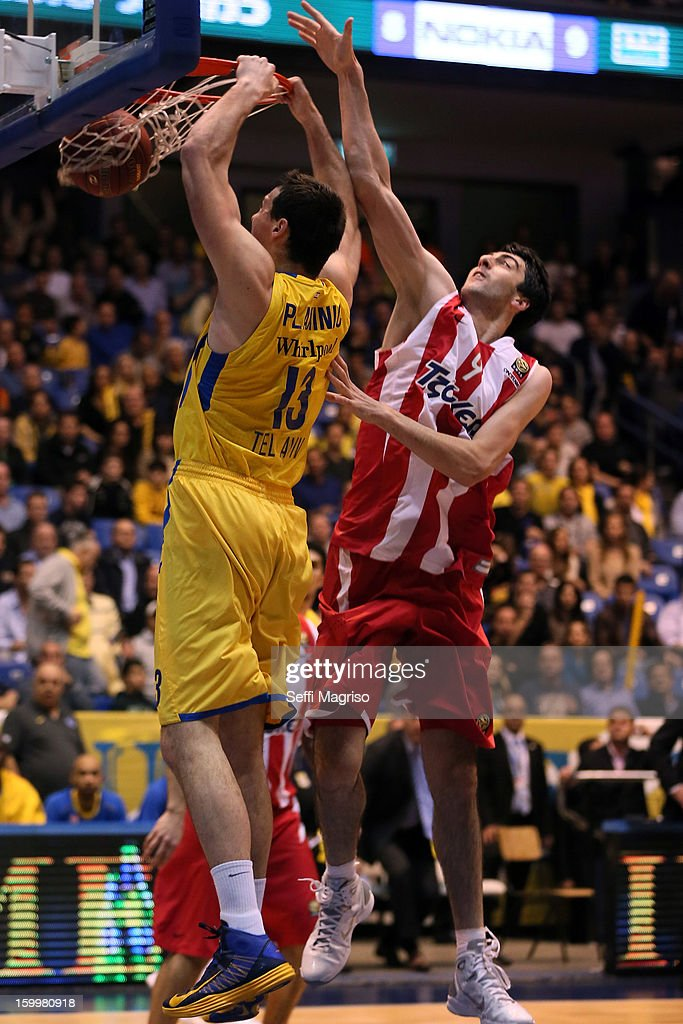 Darko Planinic, #13 of Maccabi Electra Tel Aviv competes with Shermadini Giorgi, #9 of Olympiacos Piraeus in action during the 2012-2013 Turkish Airlines Euroleague Top 16 Date 5 between Maccabi Electra Tel Aviv v Olympiacos Piraeus at Nokia Arena on January 24, 2013 in Tel Aviv, Israel.