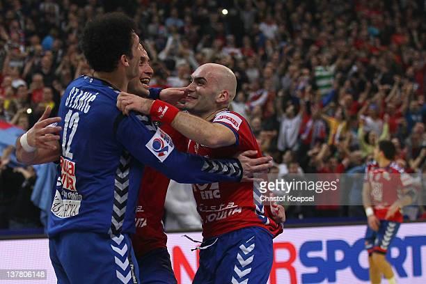 Darko Stanic Momir Ilic and Ivan Nikcevic of Serbia celebrate the 2622 victory after the Men's European Handball Championship second semi final match...