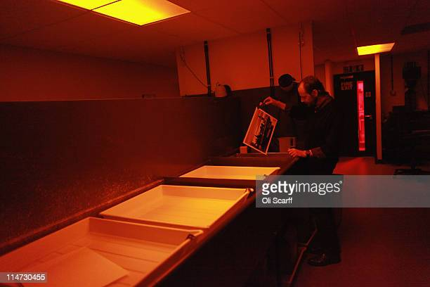 Darkroom technician Steve Eason makes black and white prints from the vast collection of historic photographs in the Hulton Archive on May 12 2011 in...
