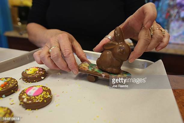 Darlene Eddy handles a skateboarding chocolate Easter bunny in her store Amazing Chocolates on March 28 2013 in Hollywood Florida Americans spend...