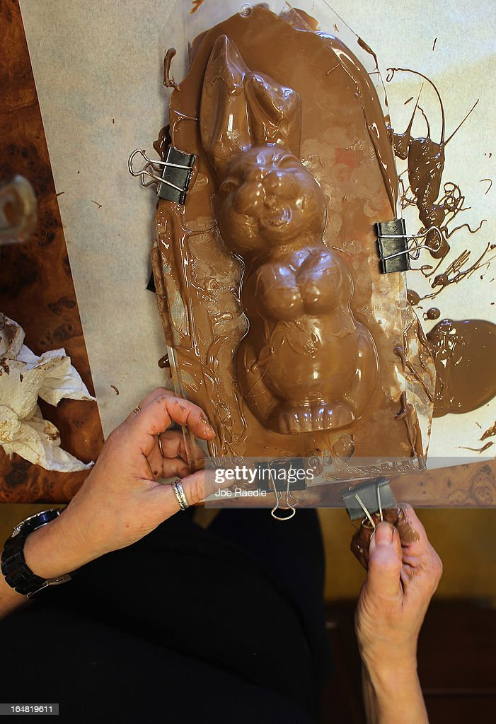 Darlene Eddy uses a mold to make a chocolate Easter bunny in her store Amazing Chocolates on March 28, 2013 in Hollywood, Florida. Americans spend roughly $1.9 billion on Easter candy, second only to Halloween in candy consumption. Around ninety million chocolate Easter bunnies are produced each year, from white to dark chocolate, and with an unlimited varieties of styles.