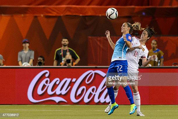 Darlene of Brazil jumps for the ball as Marta Torrejon of Spain is behind her during the 2015 FIFA Women's World Cup Group E match at Olympic Stadium...