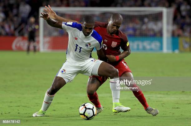 Darlington Nagbe of United States fights for the ball with Armando Cooper of Panama during the 2018 FIFA World Cup Qualifying match at Orlando City...