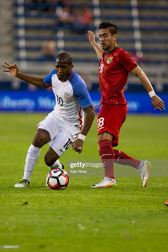<a gi-track='captionPersonalityLinkClicked' href=/galleries/search?phrase=Darlington+Nagbe&family=editorial&specificpeople=6588276 ng-click='$event.stopPropagation()'>Darlington Nagbe</a> #10 of USA navigates past Rodrigo Ramallo #18 of Bolivia early in the second half of the COPA America Centenario USA 2016 on May 28, 2016 at Children's Mercy Park in Kansas City, Kansas.