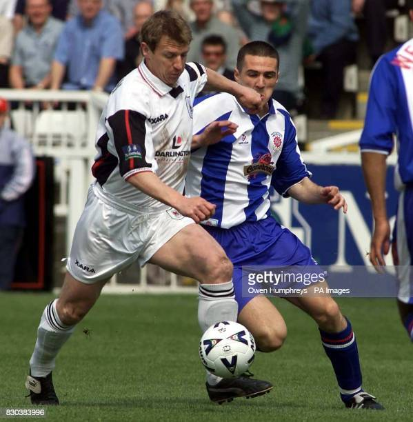 Darlington's Marco Gabbiadini battles for the ball with Hartlepool's Paul Arnison during their Nationwide League Division Three playoff semifinal at...