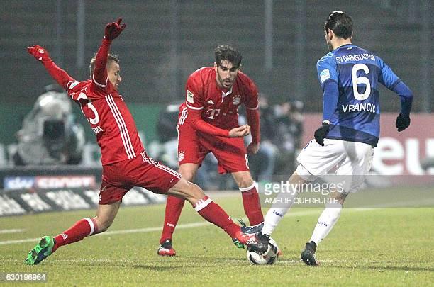 Darmstadt's Bosnian midfielder Mario Vrancic and Bayern Munich's Brazilian defender Rafinha and Bayern Munich's Spanish midfielder Javier Martinez...