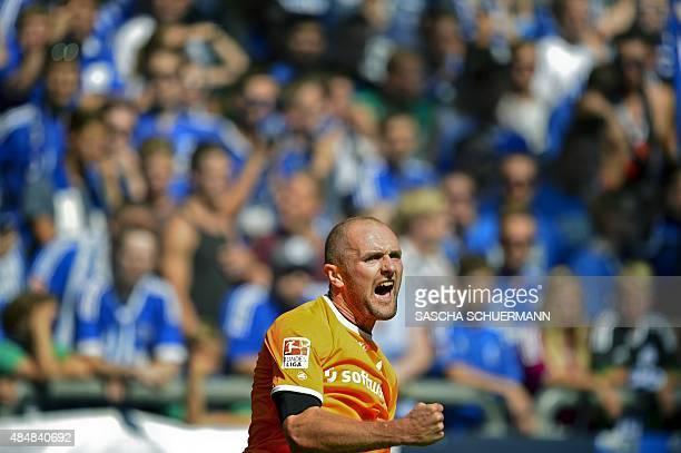 Darmstadt's defender Konstantin Rausch celebrates scoring the 10 during the German first division Bundesliga football match FC Schalke 04 v SV...