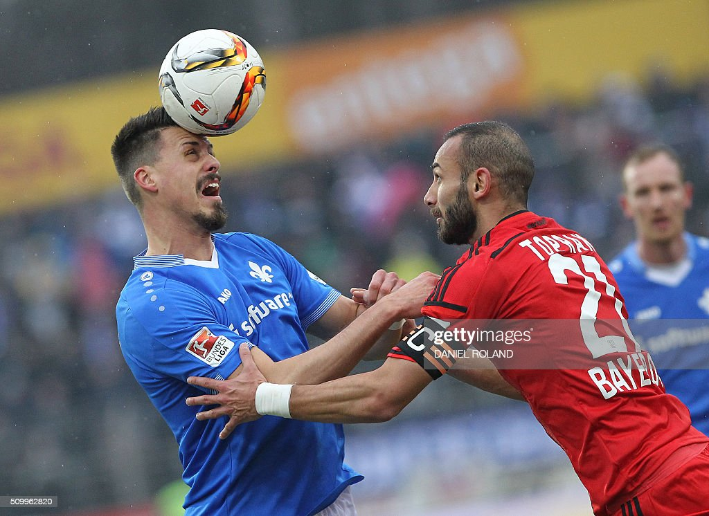 Darmstadt's forward Sandro Wagner celebrates (L) and Leverkusen's Turkish defender Omer Toprak vie for the ball during the German first division Bundesliga football match of SV Darmstadt 98 vs Bayer 04 Leverkusen in Darmstadt, western Germany, on February 13, 2016. / AFP / DANIEL ROLAND /