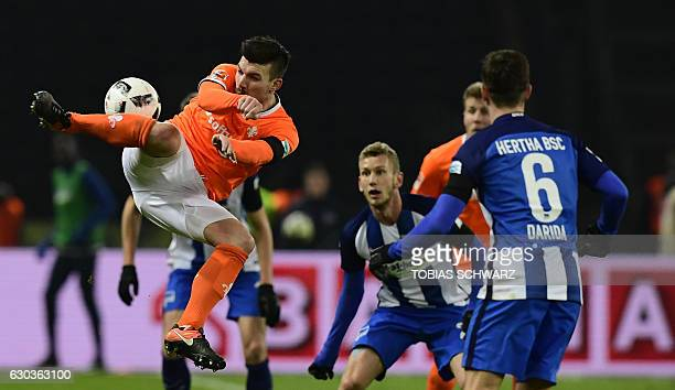 Darmstadt's midfielder Jerome Gondorf and Hertha Berlin's Swiss defender Fabian Lustenberger vie for the ball during the German first division...