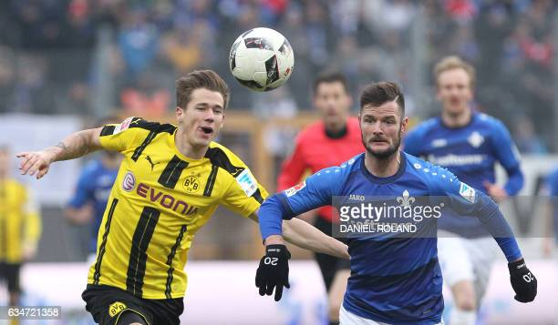 Darmstadt's midfielder Liam Fisch and Dortmund's Columbian forward Adrian Ramos vie for the ball during the German First division Bundesliga football...