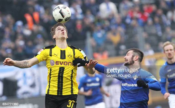 Darmstadt's midfielder Liam Fisch andDortmund's Columbian forward Adrian Ramos vie for the ball during the German First division Bundesliga football...