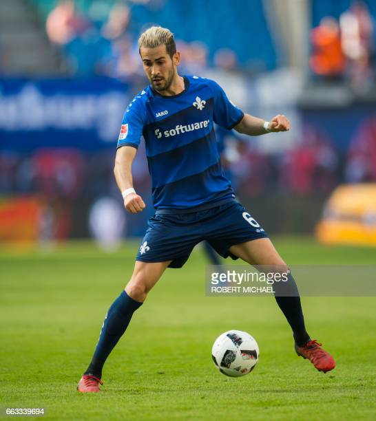 Darmstadt's midfielder Mario Vrancic plays the ball during the German First division Bundesliga football match between RB Leipzig and SV Darmstadt 98...