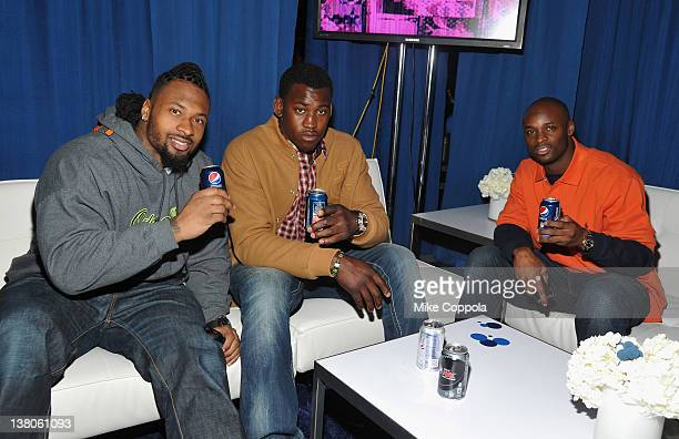 Darnell Dockett of the Arizona Cardinals Aldon Smith of the San Francisco 49ers and Reggie Wayne of the Indianapolis Colts attend Univision Pepsi...