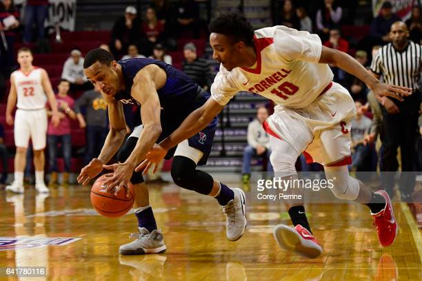 Darnell Foreman of the Pennsylvania Quakers and Matt Morgan of the Cornell Big Red chase a loose ball during the first half at The Palestra on...
