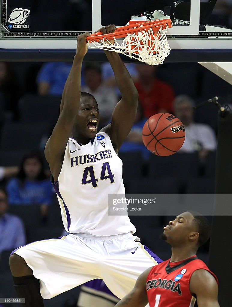 Darnell Gant #44 of the Washington Huskies dunks the ball over Travis Leslie #1 of the Georgia Bulldogs in the second half during the second round of the 2011 NCAA men's basketball tournament at Time Warner Cable Arena on March 18, 2011 in Charlotte, North Carolina.