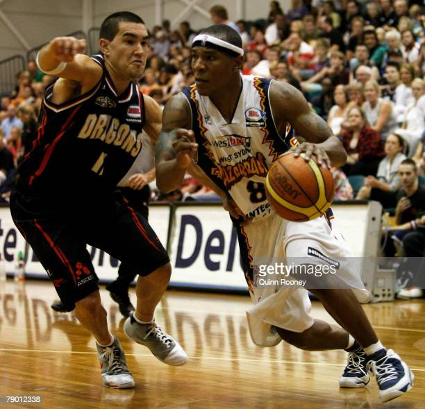 Darnell Hinson of the Razorbacks dribbles past Luke Martin of the Dragons during the round 18 NBL match between the South Dragons and the West Sydney...