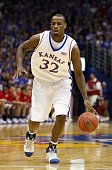 Darnell Jackson of the Kansas Jayhawks dribbles the ball during the game against the Oklahoma Sooners on January 14 2008 at Allen Fieldhouse in...