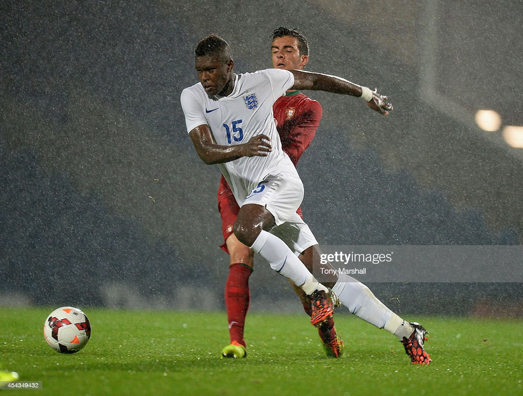 Darnell Johnson of England is tackled by Marcelo of Portugal during the Under 17 International match between England U17 and Portugal U17 at Proact Stadium on August 29, 2014 in Chesterfield, England.