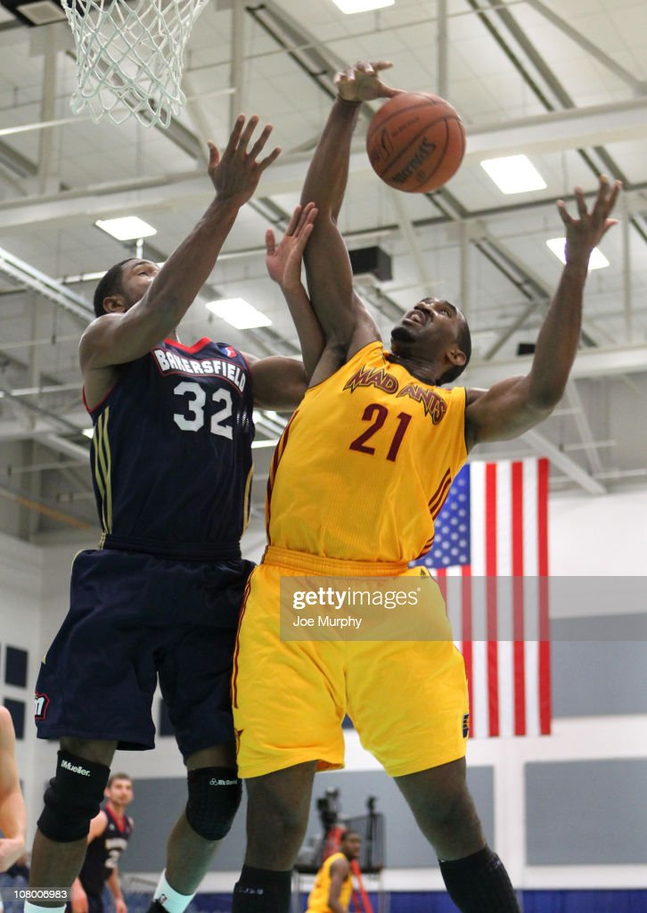Darnell Lazare #21 of the Fort Wayne Mad Ants shoots the ball over Derrick Byas #32 of the Bakersfield Jam during the 2011 NBA D-League Showcase on January 12, 2011 at the South Padre Island Convention Center in South Padre Island, Texas.