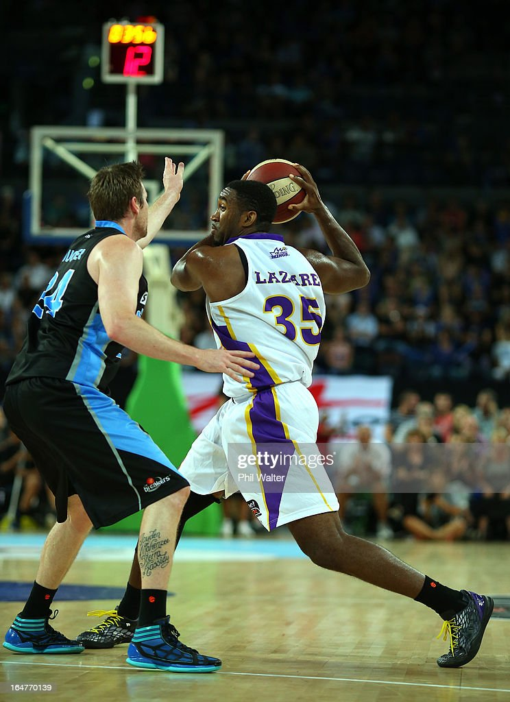 Darnell Lazare of the Kings keeps the ball clear of Dillon Boucher of the Breakers during game one of the NBL Semi Final series between the New...