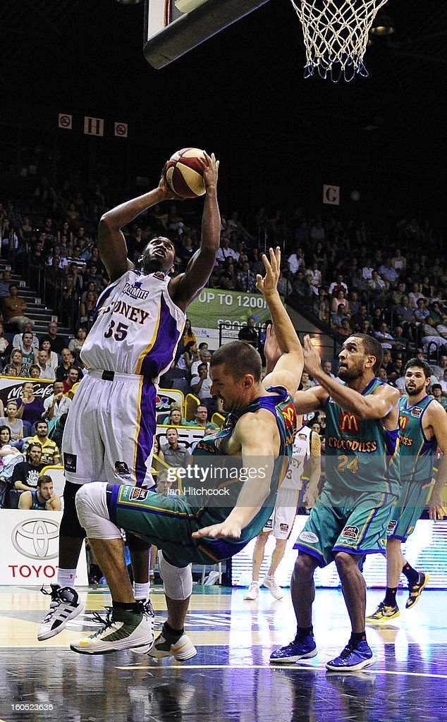Darnell Lazare of the Kings knocks over Russell Hinder of the Crocodiles during the round 17 NBL match between the Townsville Crodcodiles and the Sydney Kings at Townsville Entertainment Centre on February 2, 2013 in Townsville, Australia.