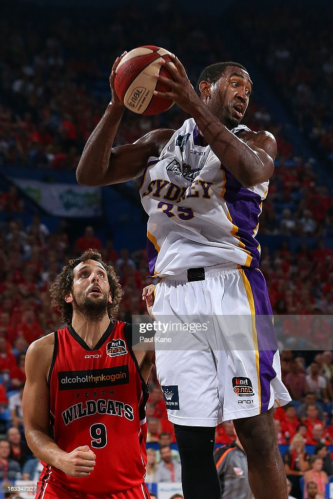 Darnell Lazare of the Kings rebounds against Matthew Knight of the Wildcats during the round 22 NBL match between the Perth Wildcats and the Sydney Kings at Perth Arena on March 8, 2013 in Perth, Australia.