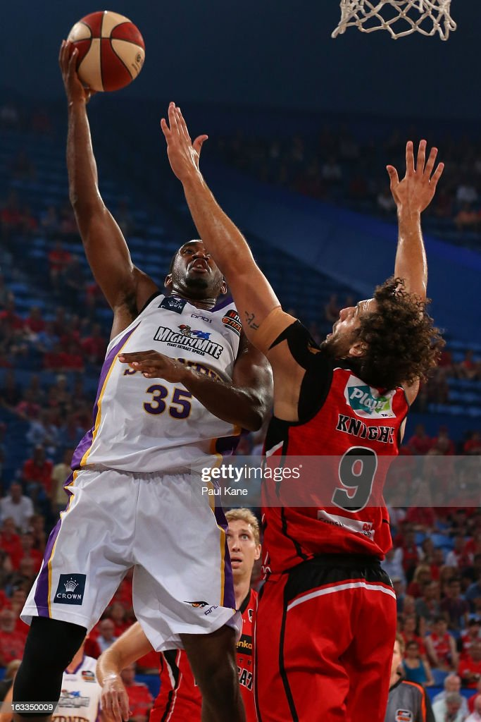 Darnell Lazare of the Kings shoots against Matthew Knight of the Wildcats during the round 22 NBL match between the Perth Wildcats and the Sydney Kings at Perth Arena on March 8, 2013 in Perth, Australia.