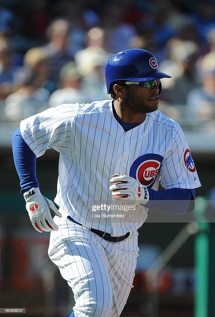 <a gi-track='captionPersonalityLinkClicked' href=/galleries/search?phrase=Darnell+McDonald&family=editorial&specificpeople=179391 ng-click='$event.stopPropagation()'>Darnell McDonald</a> #16 of the Chicago Cubs runs to first base against the Los Angeles Dodgers on February 27, 2013 at HoHoKam Park in Mesa, Arizona.