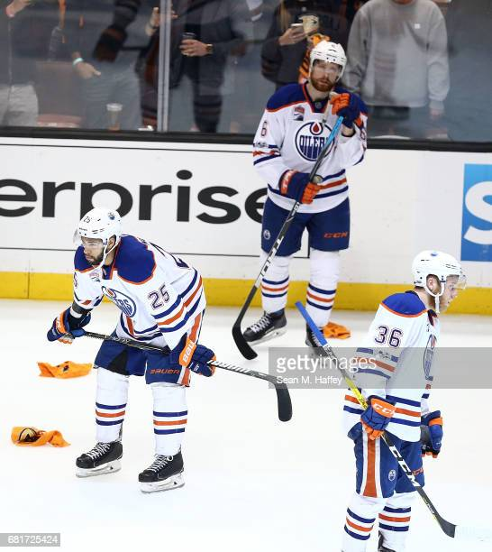 Darnell Nurse Adam Larsson and Drake Caggiula of the Edmonton Oilers react after their 21 loss to the Anaheim Ducks in Game Seven of the Western...