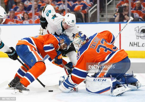 Darnell Nurse and goalie Cam Talbot of the Edmonton Oilers defend the net against Tomas Hertl of the San Jose Sharks in Game One of the Western...