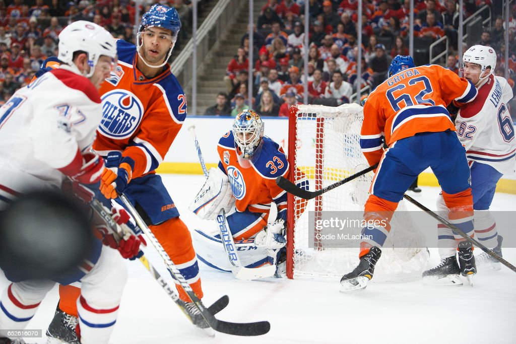 Darnell Nurse #25 and goalie Cam Talbot #33 of the Edmonton Oilers keep their eyes on the puck as Alexander Radulov #47 of the Montreal Canadiens looks for the puck on March 12, 2017 at Rogers Place in Edmonton, Alberta, Canada.