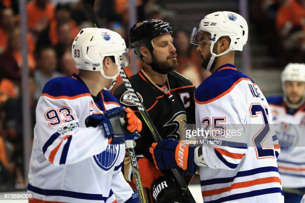 Darnell Nurse and Ryan NugentHopkins of the Edmonton Oilers push Ryan Getzlaf of the Anaheim Ducks in the first period in Game One of the Western...