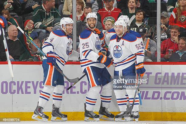 Darnell Nurse celebrates with his Edmonton Oilers teammates Taylor Hall Mark Letestu and Anton Slepyshev after scoring his first career NHL goal...
