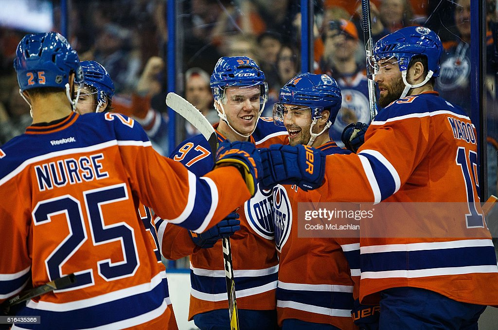 Darnell Nurse #25, Connor McDavid #97, Jordan Eberle #14 and Patrick Maroon #19 of the Edmonton Oilers celebrate Eberle's goal against Jacob Markstrom #25 (not pictured) of the Vancouver Canucks on March 18, 2016 at Rexall Place in Edmonton, Alberta, Canada.