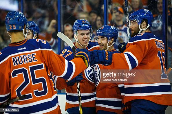 Darnell Nurse Connor McDavid Jordan Eberle and Patrick Maroon of the Edmonton Oilers celebrate Eberle's goal against Jacob Markstrom of the Vancouver...