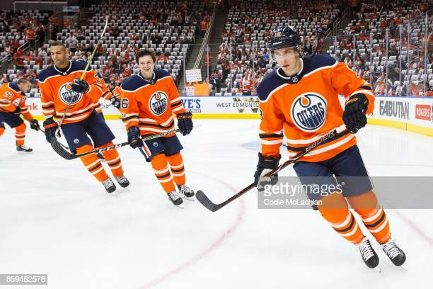 Darnell Nurse Kailer Yamamoto and Ryan Strome of the Edmonton Oilers warm up against the Calgary Flames at Rogers Place on October 4 2017 in Edmonton...