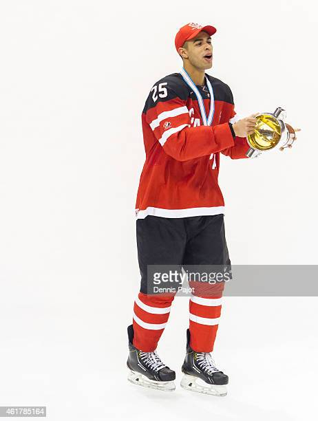 Darnell Nurse of Canada celebrates with the trophy after a 54 win against Russia during the Gold medal game of the 2015 IIHF World Junior...