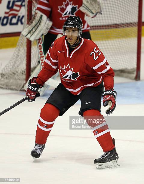 Darnell Nurse of Team Canada skates against Team Sweden during the 2013 USA Hockey Junior Evaluation Camp at the Lake Placid Olympic Center on August...