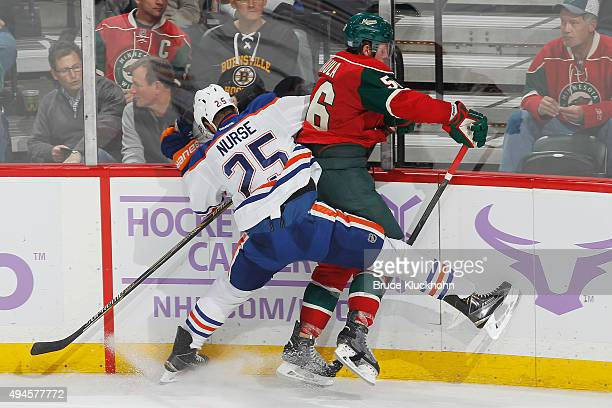 Darnell Nurse of the Edmonton Oilers and Erik Haula of the Minnesota Wild collide along the boards during the game on October 27 2015 at the Xcel...